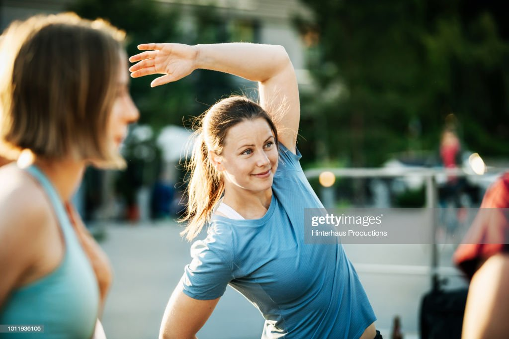 Women Warming Up Outside Together : Stock Photo
