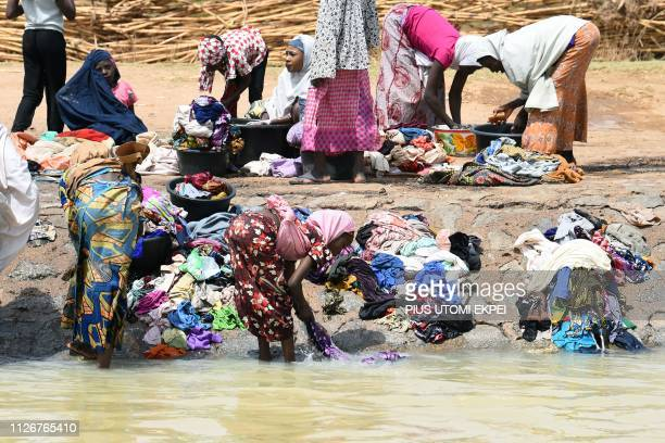 Women wash clothes in the Kura canal in northern Nigeria's Kano district on February 22 2019 The irrigation canal used for agriculture has become for...