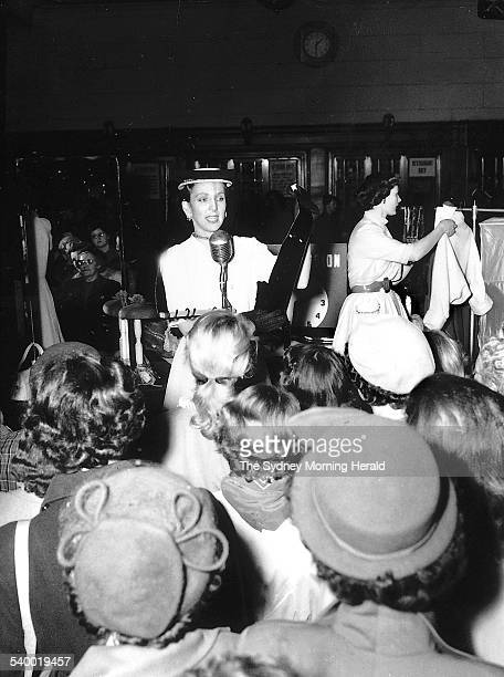 Women watch as David Jones staff demonstrate use of various clothing related objects in the Elzabeth Street store on 8 August 1952 SMH NEWS Picture...