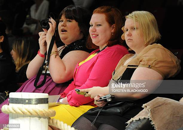 Women watch plussized models parade Myer apparel during the Big Is Beautiful opening show of the Sydney Fashion Festival on August 23 2011 The annual...