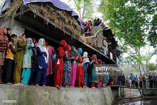Women watch the funeral procession of a militant killed in a fierce gun battle with Indian army in Pulwama district of south Kashmir.