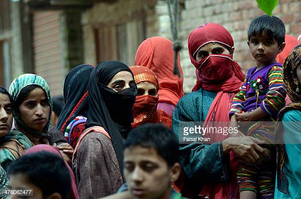 Women watch the funeral procession of a militant killed in a fierce gun-battle with Indian army in Pulwama district of south Kashmir
