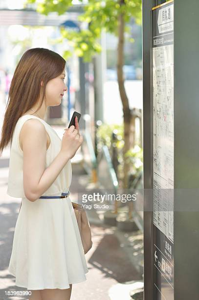 Women Watch the guide plate in the city of Kyoto