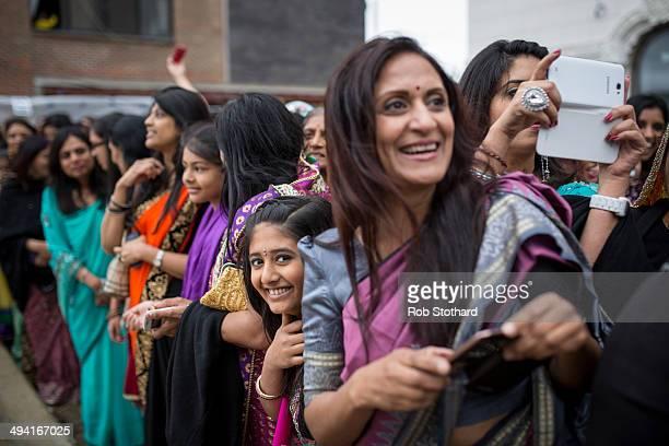 Women watch the Shree Muktajeevan Pipe Band greet the Mayor of London Boris Johnson upon arrival at the Shree Swaminarayan Mandir a major new Hindu...