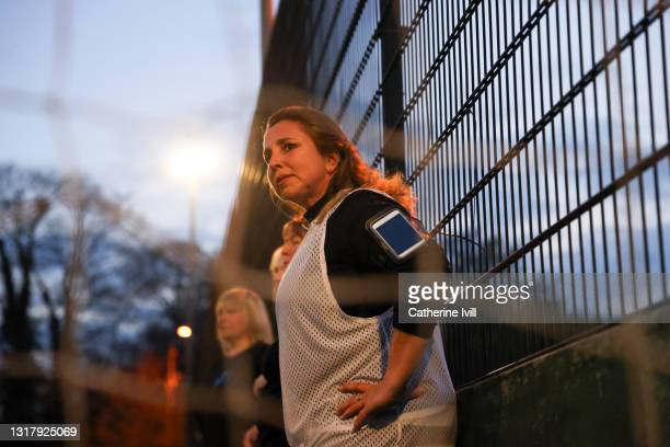 women watches her team from the sidelines - showus stock pictures, royalty-free photos & images