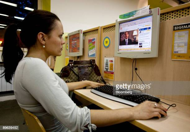 A women watches the blog page of US President Barack Obama on You Tube at an Internet cafe in Moscow Russia on Thursday July 2 2009 Dmitry Medvedev...