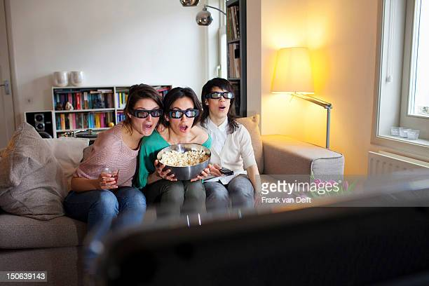 Women watching 3D movie together