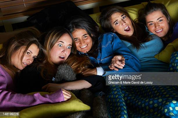 Women watching scary movie together