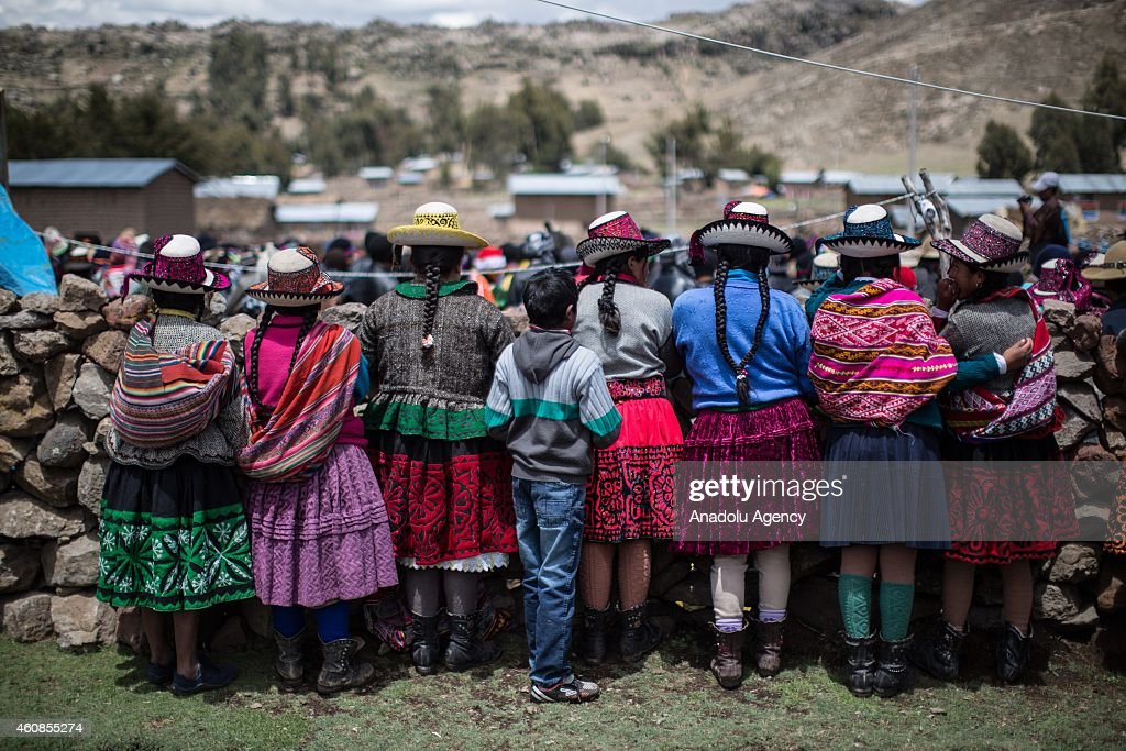 Women, wear colorful clothes, are seen during Takanakuy celebrations in the region of Chumbivilcas, Cuzco in the Andes of southern Peru on December 25, 2014. The Takanakuy is a traditional celebration held every December 25. The celebration can last many days. The word 'Takanakuy' means 'to strike with the fist' and fighters are heating with dances and songs called Wayliyas. Men and women who have had problems with other people during the year are fixing their conflicts at the end of the year with one or several fights. Usually, conflicts are raised by issues related to land or harvesting, stealing animals or insulting the name of the father. Some collisions are caused by love or friendship issues.