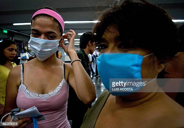 Women wear face masks as prevention against the swine flu virus at the subway in Mexico City on April 24 2009 An outbreak of deadly swine flu in...
