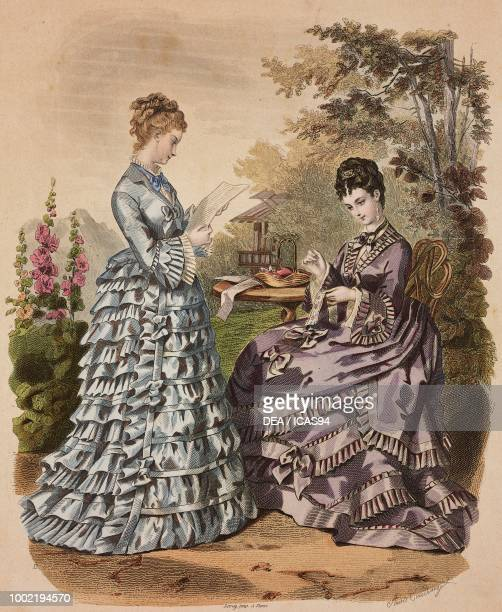 Women wearing a blue day dress and purple dress with flounces ribbons and bows Madame Fladry designs France coloured engraving from La Mode Illustree...