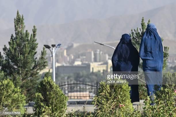 Women wearing a blue-coloured burqa visit the Wazir Akbar Khan hilltop in Kabul on June 13, 2021.