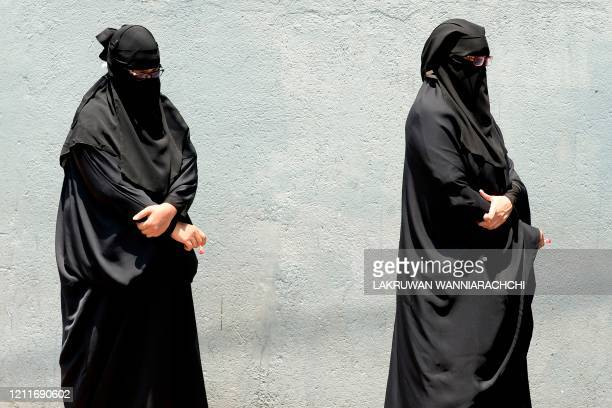 Women wearing a burqa wait as they line up to take a blood sample for a COVID-19 coronavirus test during a government-imposed nationwide lockdown as...