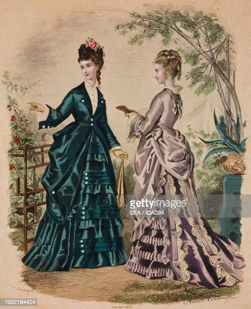 Women wearing a dark green walking dress and lilac day dress Madame Fladry designs France coloured engraving from La Mode Illustree No 42 October 19...