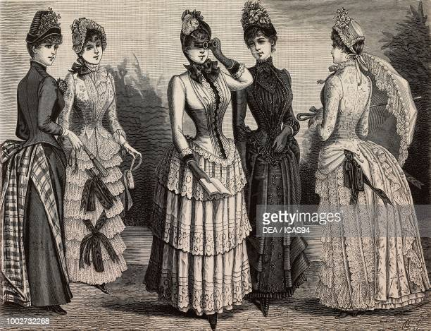 Women wearing a dress in Sicilienne and checkered wool a dress in patterned batiste a dress in Scottish batiste a silk and voile dress a patterned...