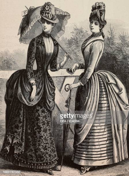 Women wearing a Faille dress with umbrella a woolen dress with umbrella designs by Madame Coussinet engraving from La Mode Illustree No 29 July 19...