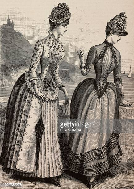 Women wearing a plain and embroidered flannel dress and a cloth dress with golden borders designs by Madame Coussinet engraving from La Mode...