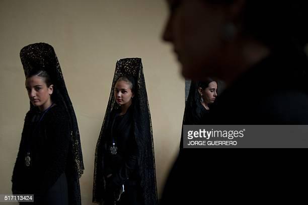 Women wearing a traditional Mantilla take part Jesus de las Tres Caidas y Nuestra Senora del Rosario brotherhood procession on March 23 2016 in...