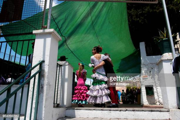 Women wearing a typical flamenco dress seen on the street of streets of Albaicin neighbourhood El día de la Cruz or Día de las Cruces is one of the...