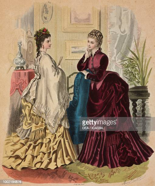 Women wearing a yellow dress and white wool shawl with fringe and burgundy day dress Madame BreantCastel designs France coloured engraving from La...