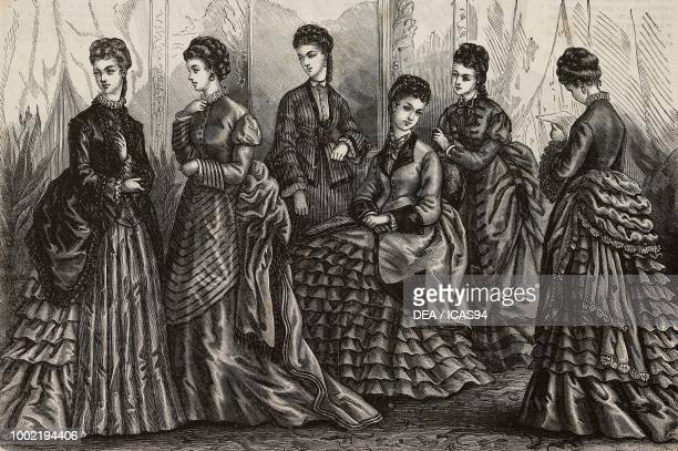 Women wearing autumn and winter dresses with jackets and skirts with folds and flounces Madame BreantCastel designs France engraving from La Mode...