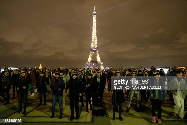 TOPSHOT Women wearing black blindfolds take part in a flash mob to protest against femicide and sexual violence organised by the feminist collective...