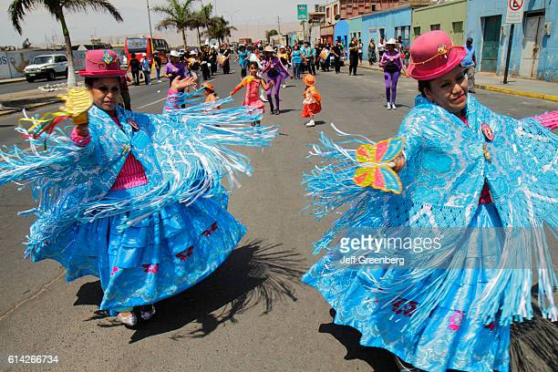 Women wearing chola dresses at the Andean Carnival parade rehearsal