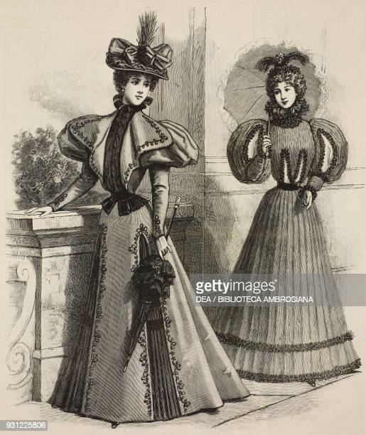 Women wearing dark dresses suitable for girls and young women full skirts and puffedsleeves carrying umbrellas Gazette de la Famille No 6812 1896