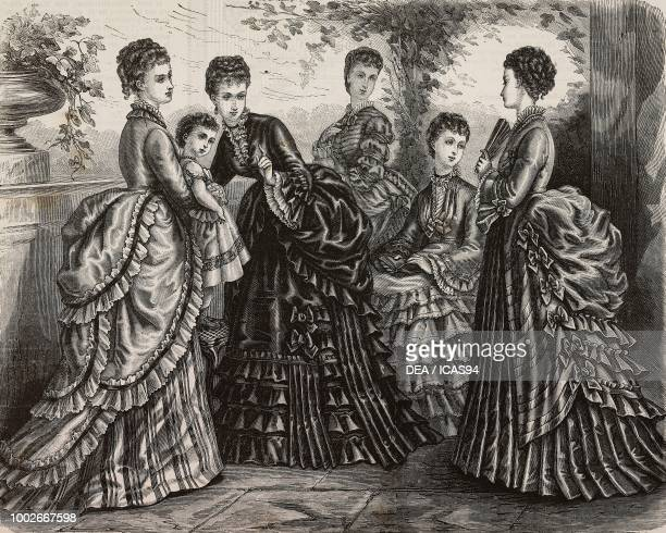 Women wearing day dresses with pleated skirts or with flounces engraving from La Mode Illustree No 39 September 28 1873