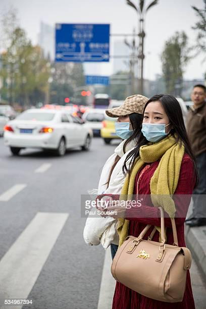 Women Wearing Dust Masks, Chengdu, Sichuan Province, China