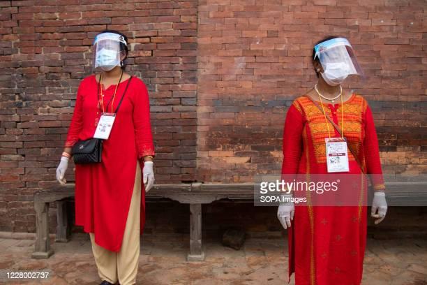 Women wearing face shields face masks and gloves as a preventive measure during the festival at Krishna Mandir Krishna Janmashtami is an annual Hindu...