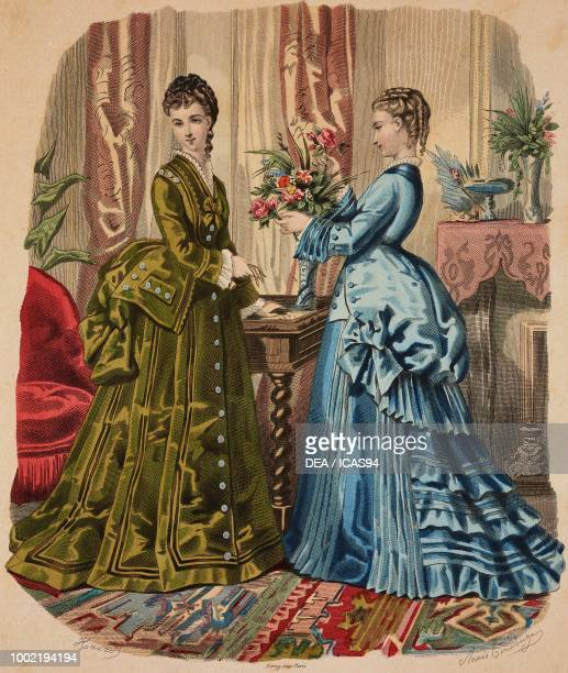 Women wearing green and blue day dresses Madame Fladry designs France coloured engraving from La Mode Illustree No 38 September 21 1873
