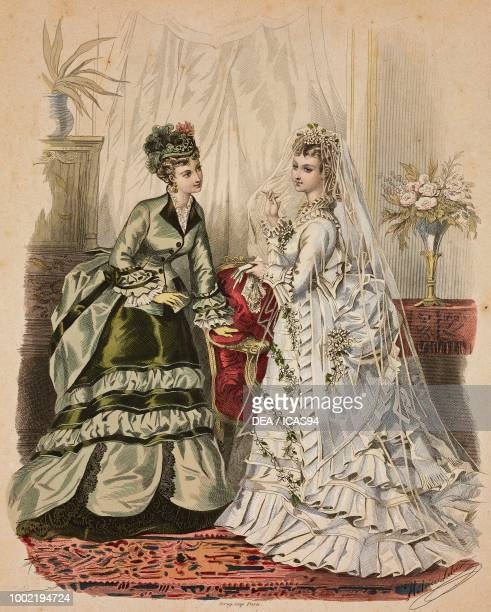 Women wearing green walking dress and in a wedding dress with veil Madame Fladry designs France engraving from La Mode Illustree No 46 November 16...