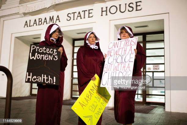 MONTGOMERY AL MAY 14 Women wearing Handmaid costumes protest in front of the Alabama State House after the State Senate passed HB314 which banned...