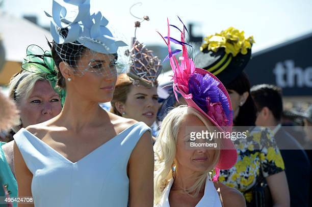 Women wearing hats and fascinators participate in the Fashions on the Field competition during Melbourne Cup day at the Flemington racecourse in...