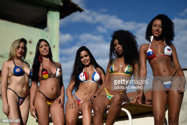 Women wearing insulating tape bikinis with flag colours of some countries taking part in the 2018 FIFA World Cup sunbathe to have the perfect bikini...