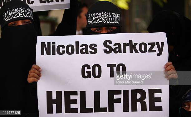 Women wearing Islamic niqab veils stand outside the French Embassy during a demonstration on April 11 2011 in London England France has become the...