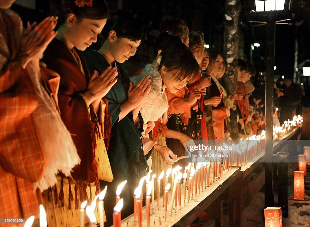 Women wearing kimono light candles and pray for marriage tie during the Santera Mairi on January 15, 2013 in Hida, Gifu, Japan. The tradition is originally to visit San-tera, or three temples in the area to worship monk Shinran, turned to the event for young women seeking romance in Meiji era, after occasionally parents looking for bride for their sons founded dressed up young girls during the event.