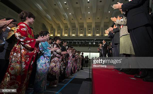 Women wearing kimonos and visitors applaud during a ceremony marking the first trading day of the year at the Tokyo Stock Exchange operated by Japan...