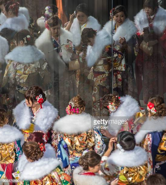Women wearing kimonos are reflected in a window as they gather after attending a Coming of Age ceremony on January 8 2018 in Yokohama Japan Coming of...