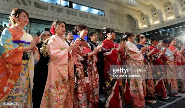 Women wearing kimonos clap their hands at the 'Daihakkai' ceremony marking the frist trading of the New Year at the Tokyo Stock Exchange on January 4...