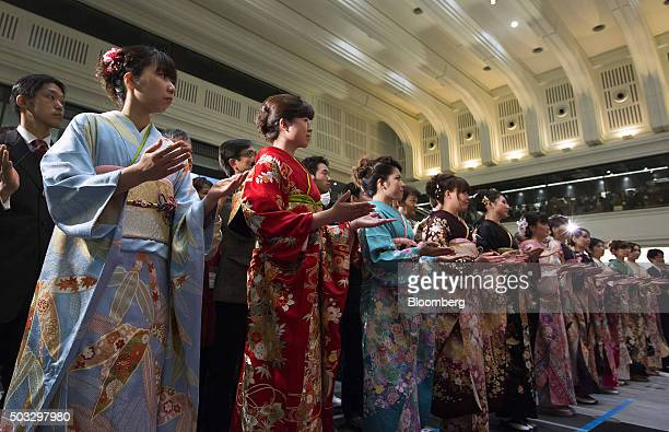 Women wearing kimonos perform during a ceremony marking the first trading day of the year at the Tokyo Stock Exchange operated by Japan Exchange...