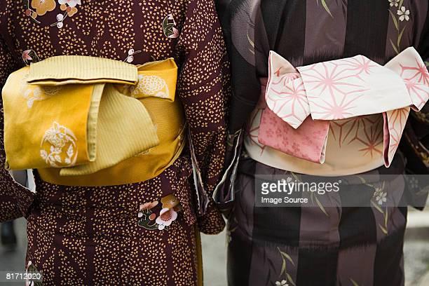 women wearing kimonos - obi sash stock pictures, royalty-free photos & images