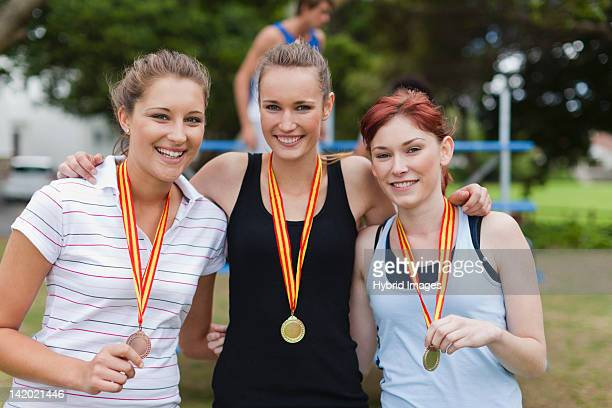 Women wearing medals in park