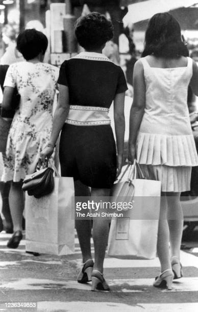 Women wearing miniskirts walk on the street on August 29 1968 in Tokyo Japan