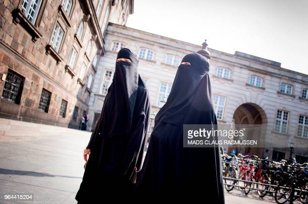 Women wearing niqab are pictured in front of the Danish Parliament in Copenhagen Denmark on May 31 2018 The Danish parliament on Thursday May 31...