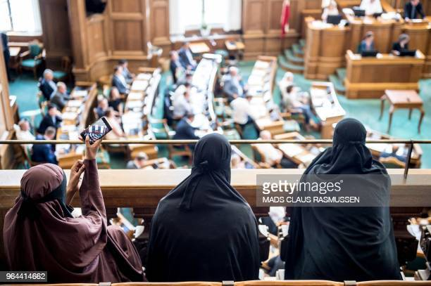 TOPSHOT Women wearing niqab sit in the audience at the Danish Parliament in Copenhagen Denmark on May 31 2018 The Danish parliament on Thursday May...