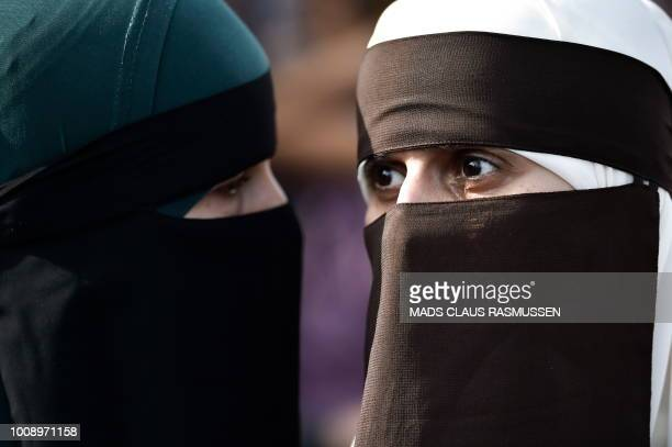 Women wearing niqab to veil their faces take part in a demonstration on August 1 the first day of the implementation of the Danish face veil ban in...
