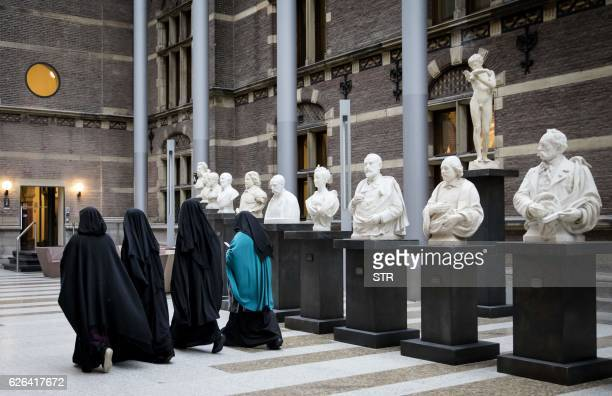 Women wearing niqab visit the Senate on November 23 2016 in the Hague the Netherlands Dutch MPs on November 29 2016 voted by a large majority to...