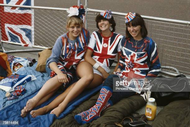 Women wearing patriotic costumes wait in London for the royal newlyweds Charles and Diana 29th July 1981